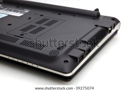 A white background studio isolated shot of the underside of a laptop.