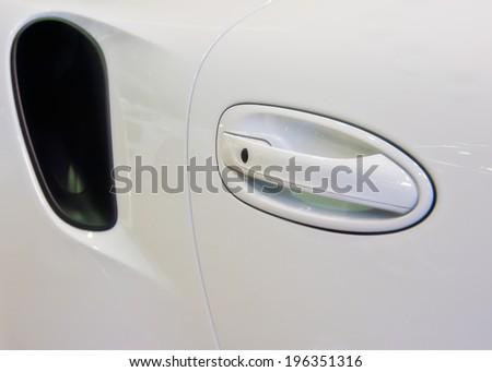 a white caar door handle - stock photo