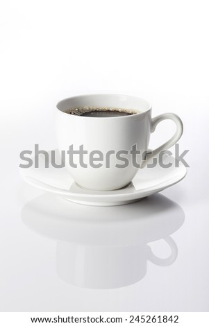 A white coffee cup and black coffee on the reflect bottom isolated white at the studio. - stock photo