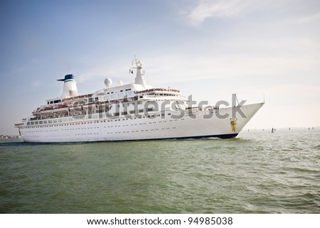 A white cruise ship floating in the sea - stock photo