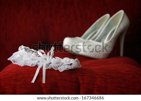 A white garter and shoes. Shallow depth of field. - stock photo