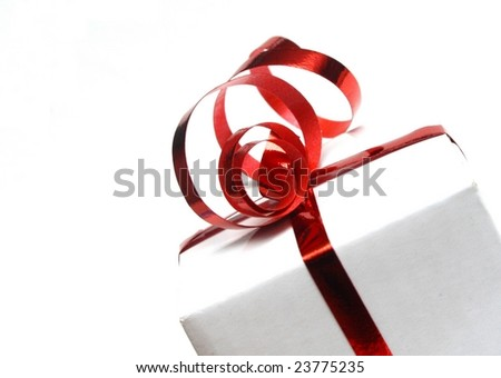 A white gift wrapped with red ribbon - stock photo