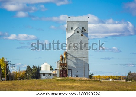A white grain elevator in a small prairie town in Canada - stock photo