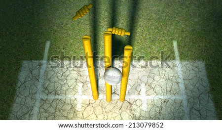 A white leather cricket ball hitting wooden cricket wickets on a grass cricket pitch background - stock photo