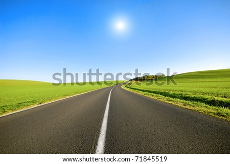 a white line on a road in the french countryside - stock photo