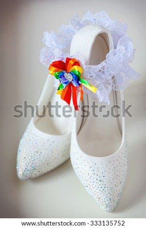 A white linen garter with a coloured bow - stock photo