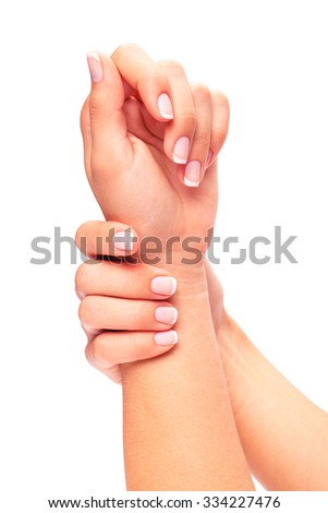 a white manicure on a hand is isolated on a white background - stock photo