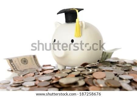 A white piggy bank wearing a graduation cap, sitting on a heap of bills and change -- signifying the expense of college or new hopes for earnings.  On a white background.   - stock photo