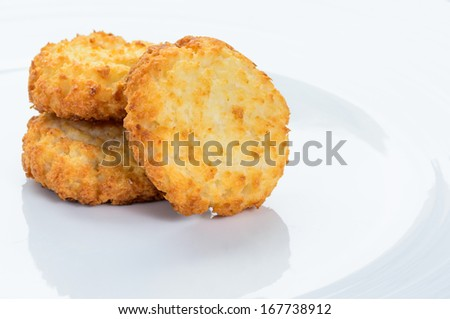 A white plate with coconut macaroons - stock photo