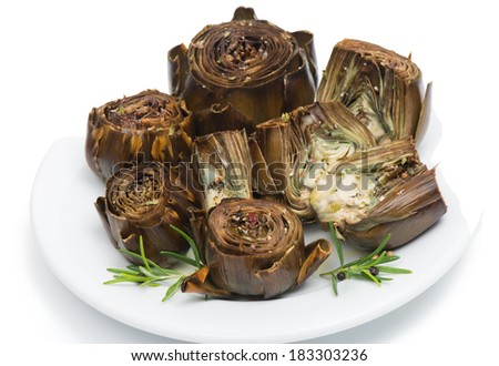 A white plate with cooked artichokes  decorated with fresh rosemary , isolated on a white  background. - stock photo