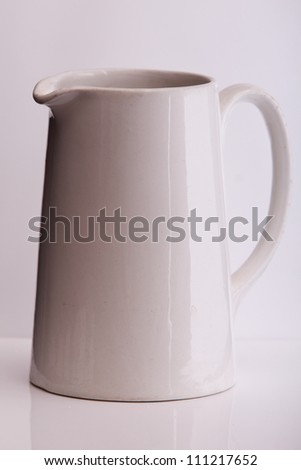 a white porcelain milk jug