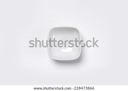 A white small bowl isolated white(grey) and top view. - stock photo