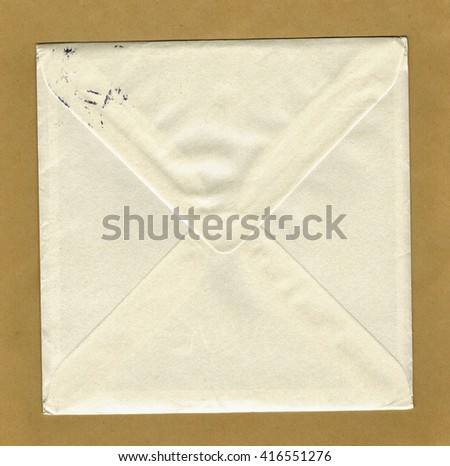 A white square mail letter envelope over light brown paper background - stock photo