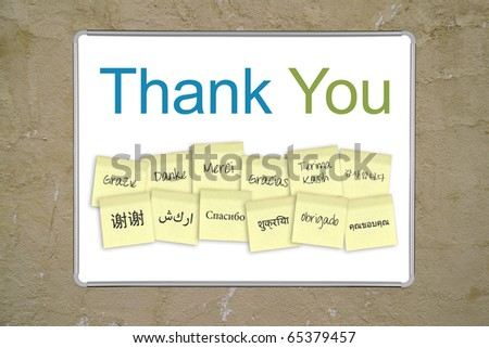 "A whiteboard with the words ""thank you"" in 13 different languages. Outer and inner clipping paths for the whiteboard included. - stock photo"