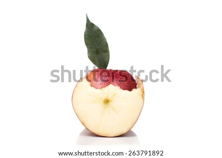 a whole ripe apple with a slice bitten - stock photo