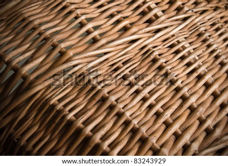 a wicker basket close-up photo texture with shallow depth of field - stock photo