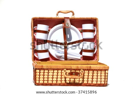 A wicker picnic basket with a red gingham cloth isolated on a white background - stock photo