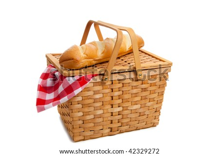 A wicker picnic basket with french bread on a white background - stock photo