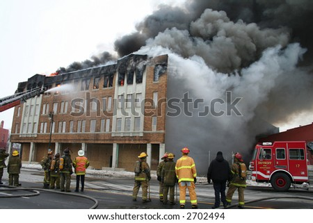 A wid-eangle view of an apartment fire in Detroit - stock photo