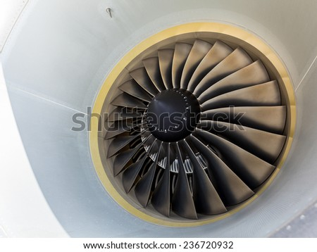 A wide angle close-up view of an airplane engine blade.