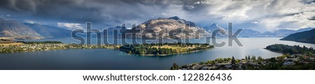 A wide angle landscape panorama of Lake Wakatipu in Queenstown, New Zealand - stock photo