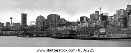 A wide angle panoramic photo of the Seattle skyline and waterfront in Washington. - stock photo