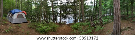 A wide angle panoramic view of a heavily wooded camp site in the Adirondacks. - stock photo