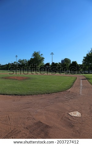 A wide-angle shot of an unoccupied baseball field.  - stock photo