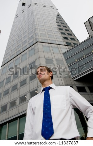 A wide angle shot of businessman and skyscrapers