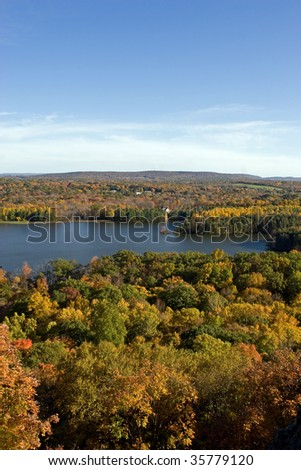 A wide angle view of peak foliage in New England in the fall or autumn season. - stock photo