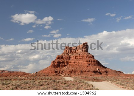 "A wide angle view of sandstone buttes in Utah's ""Valley of the Gods"""
