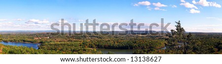 A wide open panoramic shot of New England during early autumn. - stock photo