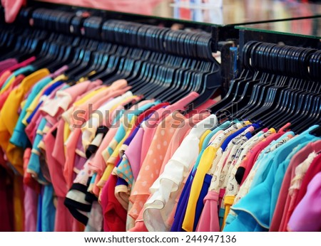 A wide range of women's blouses in store. - stock photo