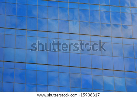 A wild cloud reflected in the bright blue glass of an ultra modern building in West Hollywood, Los Angeles, California. - stock photo