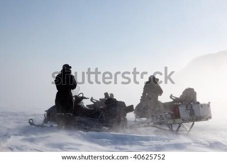 A wild winter storm in a barren mountain landscape - stock photo