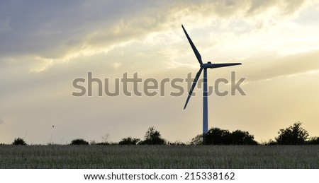 A wind farm against the cloudy sunset
