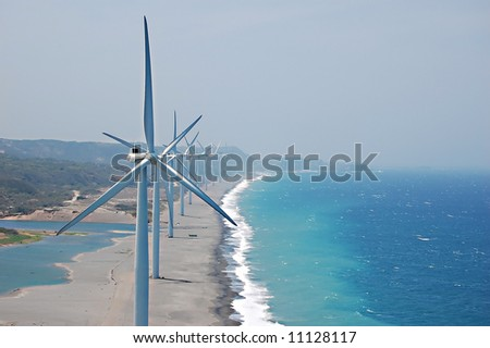a wind farm seen atop of another with turbine in the philippines - stock photo