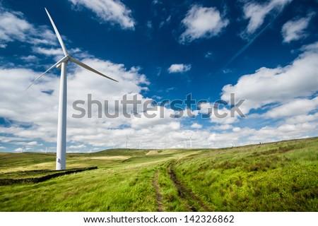 A Wind Turbine on a Wind Farm - stock photo