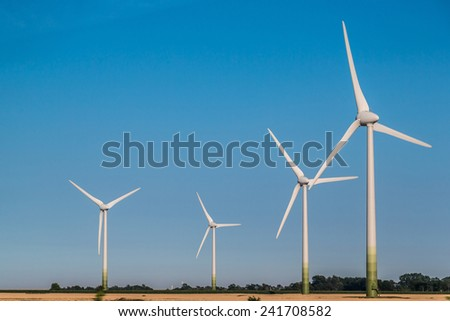 A Wind Turbine on a Wind Farm  in summer day