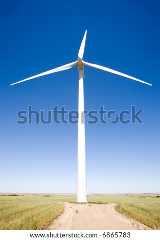 A wind turbine on the flat prairie viewed from below - stock photo