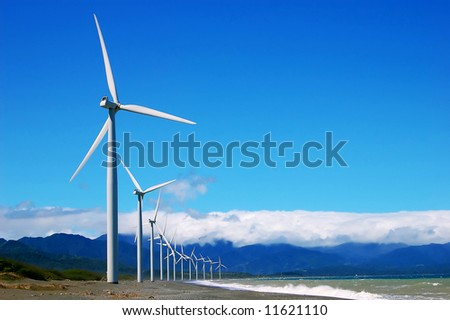 a windfarm on a single row in bangui bay, philippines