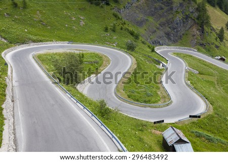 A winding, dangerous mountain road - stock photo