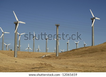 A windmill down for repair on a windfarm - stock photo
