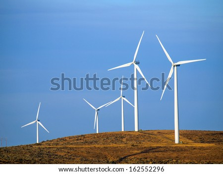 A Windmill Farm on a Mountain at Dusk - stock photo