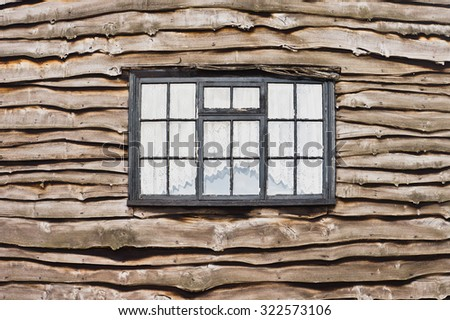 A window in a wooden cottage - stock photo
