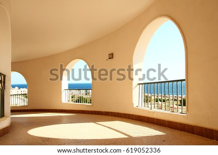 a Windows arch with sea view