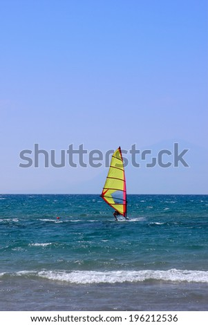 A windsurfer passing by