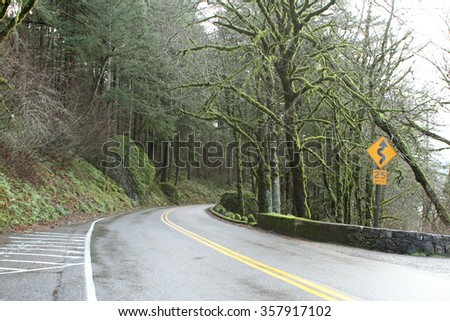 A windy road in the mountains. - stock photo