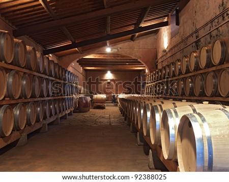 A wine cellar full of barrels of wine in Tuscany (Chianti) - stock photo