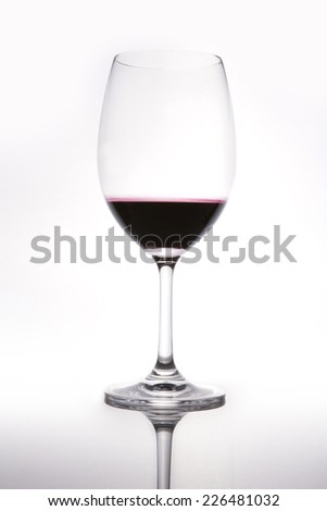 A wine glass with wine isolated black. - stock photo